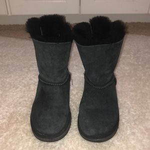 Short black UGG boots with ribbon bows on the back